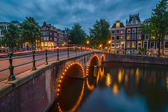 Bridge lights (angheloflores) Tags: travel bridge houses sunset sky urban netherlands colors amsterdam architecture night clouds lights canal explore keizersgracht reflcetions