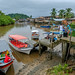 Nuqui's river harbor and boats ready to take tourists to their lodges