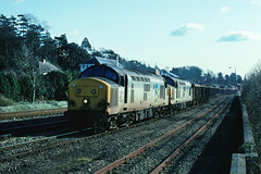 A few miles furthe saarf....two tractors rev up ready to tackle the climb to Whiteball on leaving Exeter....6B19 37203/037 Exeter-Newport ADJ leaving Riverside yd 20-02-1993 (the.chair) Tags: 6b19 37203037 exeternewport adj scrap departing riverside yd feb 1993