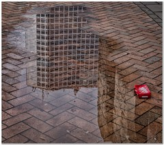 Urban reflections (Hugh Stanton) Tags: reflections puddle pattern