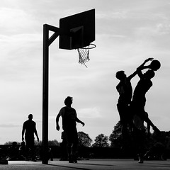 game (jaumescar) Tags: park light shadow sky people bw white black game silhouette basketball sport contrast ball square fun team jump movement basket nest action outdoor background sony instant players teamwork