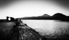 The Way To Jura (scamart1st) Tags: sea white black water scotland pier jetty whiskey hills islay jura bandw distillery