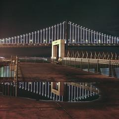 Bridge reflection (-Alberto_) Tags: sanfrancisco california reflection landscape baybridge bayarea carlzeiss hasselblad500cm