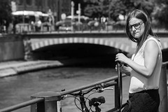 In the eyes... (Periades) Tags: street blackandwhite bw woman girl bike bicycle cycling glasses blackwhite eyes noiretblanc candid femme streetphotography nb yeux human cycle rue lunettes fille vlo cheveux photoderue streethuman