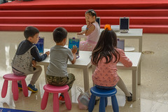 learning (stevefge) Tags: china scienceandtechnologymuseum shanghai museum people candid children kids kinderen boys girls young tablet stool reflectyourworld
