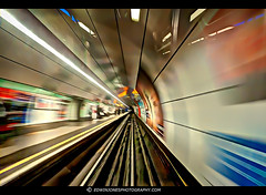 Bank Station Departure Speed (Edwinjones) Tags: pictures uk blue england urban motion blur color colour green london glass station yellow speed train underground concrete photography lights photo office movement colours metro photos action britain sony capital transport tube perspective tracks picture cities cityscapes sigma rail wideangle tunnel pic structure transportation londres dlr hdr highdynamicrange shutterspeed docklandslightrailway photomatix tonemapped dslra700