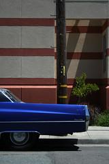 blue murder (Dill Pixels (THE ORIGINAL)) Tags: auto blue shadow car wheel automobile suburbia cadillac fender crop fin onewheel