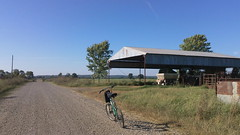 cycling the majestic farmland roads (under the skies of arkansas) Tags: road bicycle barn cycling countryside farmland arkansas roads hay majestic gravel