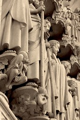 suspended saints (bernawy hugues kossi huo) Tags: city urban sculpture paris france building art history sign stone architecture composition photo blackwhite arquitectura artist crossing time noiretblanc sony picture saints style historic architect repair architektur suspended notre dame schwarzweiss civilisation cathedrale artdistrict artiste artisanat architecte 200mm cariatide volute arkitekt 2013 blanconero arkitect