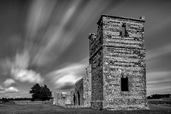 Knowlton Church (Chris Jones www.chrisjonesphotographer.uk) Tags: old uk blue chris england west building church water grass stone clouds jones movement ancient long exposure south bluewater structure historic norman christian dorset ritual flint knowlton pagan neolithic henge earthworks earthwork chrisjones bluewaterphotography bluewaterphoto bluewaterphotographycouk chrisjonesbluewaterphotography chrisjonesbluewaterphotographycouk