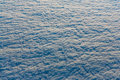 Texture of a Thick Cloud Layer Viewed from Above (Lee Rentz) Tags: above winter sky usa cloud texture clouds america plane airplane landscape pattern view aviation flight aerial layer northamerica layers wrinkles airliner viewed wrinkled cloudbank