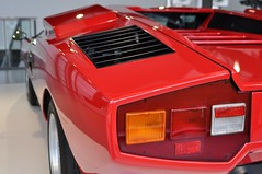 Lamborghini Countach LP400 (1975) (Transaxle (alias Toprope)) Tags: sports car museum spectacular lights design engine machine super racing legendary sharp most lp radical marcello lamborghini 1973 wolfsburg futuristic autostadt weber styling countach gandini edges lambo eyecatching proportions bertone topspeed 300club dohc midengined scissordoors club300 marcellogandini twelvecylinder 45dcoe longitudinaleposteriore overheadcamshafts 315kmh ar2l