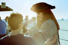 Olympus 35DC Pier Pressure Cap'n Jack Conspiring (▓▓▒▒░░) Tags: california camera venice classic film beach japan 35mm vintage jack losangeles santamonica rangefinder olympus retro sparrow captain midnight boardwalk cpn ridazz pierpressure crankmas crankmob