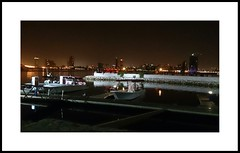 Night Talk (Manal Photography) Tags: sea reflection night dark boats lights bahrain passionate manal