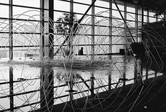 Things to See in the Detroit Airport (JasonCameron) Tags: city white black reflection film water fountain flow airport detroit olympus terminal splash dtw