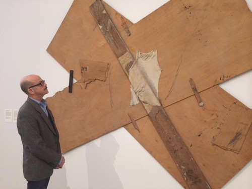 """Dr. David Newman perusing a Tapies work at the opening night of """"From Within"""" at the Perez Art Museum"""