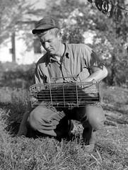 Man with Animal in Cage (MSA) (MissouriStateArchives) Tags: animals wildlife missouri mink weasel missourihistory