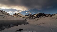 la luce se ne va (TIMPICE) Tags: sky mountain lake ice water clouds landscape lago natur montagna paesaggio miserin