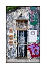 Graffiti (Zabou), East London, England. (Joseph O'Malley64) Tags: door uk greatbritain england streetart london lamp four graffiti stencil mural gate paint britain pavement spray doorway posters british cans aerosol brickwork lintel eastend eastlondon pasteups rooftiles billposters muralist londonplanetree ornamentalironwork zabou stencilwork victorianstructure