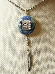 I made this with the writer in mind. Little round ceramic blue and turqoise textured disc with typewriter on top and dangling feather. (Suzie the Foodie www.suziethefoodie.com) Tags: blue typewriter ceramic this with little top feather made mind round writer disc dangling textured turqoise i