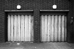 Two Garage Doors (Apionid) Tags: film monochrome rollei nikon doors garage symmetrical fm2n werehere day139366 retro400s hereios 366the2016edition 3662016 18may16