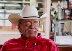 Watching The Livestock Show (J Wells S) Tags: carnival ohio portrait glasses georgetown mustache cowboyhat redshirt candidportrait westernshirt browncountyfair browncountyohio thelittlestatefair