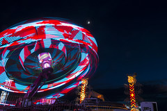 Carnival is in Town (aaronrhawkins) Tags: carnival rides spin spinning startrooper zipper sick longexposure moon crescentmoon summerfest summernights summer party orem utah red blue colors circles night sky colorful
