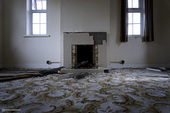 Keep the home fires burning... (mydoghasnono.se) Tags: urbex urbanexploration livingroom home house fireplace fire heating warmth cold abandoned empty carpet rot