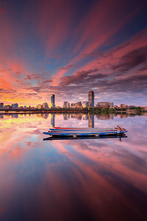 Dragon Boats on Charles River at Sunrise with Boston Skyline and Mirror Reflection