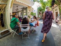 Posh Cafe - Shopping Street - Myrina Town-  Lemnos ( Fisheye View) (Olympus OMD EM5 & mZuiko 8mm f1.8 Fisheye Prime) (1 of 1) (markdbaynham) Tags: island greek north aegean hellas evil olympus greece grecia zuiko omd csc oly mz limnos hellenic m43 zd mft lemnos myrina em5 mirrorless micro43 microfourthird micro43rd mzuiko m43rd em5ii zuikolic