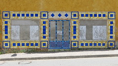 No entry: A tile mural on the street wall of a tile factory in Salernes, Var, Provence, France (Hunky Punk) Tags: ceramic tile mural salernes var provence street building wall door window curtains white lace