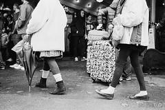 Luggage Tourists (Taomeister) Tags: seattle tourists luggage pikesplacemarket ilfordpan400 yashicat4superd tessar3535t breakfastfilmclub