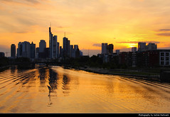 Skyline @ Sunset, Frankfurt, Germany (JH_1982) Tags: sky yellow orange red sun glow sunset ocaso sonnenuntergang coucherdesoleil prdosol tramonto  zonsondergang zachdsoca solnedgng solnedgang auringonlasku apus  matahariterbenam mttriln   purple blue cloud clouds cloudy wolken skyline evening highrises skyscrapers wolkenkratzer hochhuser main river fluss reflection cityscape urban urbanity city spiegelung frankfurt frankfurter francfort frncfort francoforte meno     hessen hesse germany deutschland allemagne alemania germania