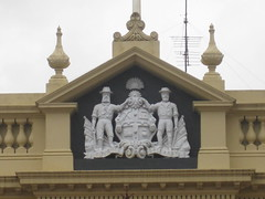 Coat of Arms Detail of the Ballarat Old Colonists Club  Lydiard Street, Ballarat (raaen99) Tags: door city windows roof building window yellow urn architecture club facade hall iron coatofarms arch balcony pillar 19thcentury australia victoria doorway castiron symmetrical classical column verandah 20thcentury nationaltrust moulding ballarat association goldrush 1889 1900s parapet nineteenthcentury revival ballustrade 1880s 1901 countryvictoria 1887 1888 twentiethcentury heritagelisted archedwindow classicalrevival goldrushera buildingdate classicalrevivalstyle provincialvictoria lydiardstreet classicalrevivalarchitecture oldcolonistshall pedement lydiardst architecturallydesigned castironverandah oldcolonistsclub classicalrevivalbuilding ballaratoldcolonistsclub oldcolonistsassociation colonistsassociation doublestageparapet