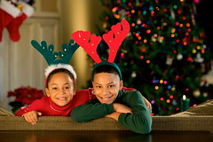 755907741 (Pnitest Account) Tags: christmas boy portrait girl smiling reindeer costume sister brother humor christmastree couch indoors brunette ethnic antler digitalcapture royaltyfree lookingatcamera