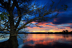 River Dreaming (TonyinAus) Tags: sunset water weather silhouette clouds canon australia rivers