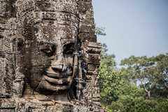 mpressive face sculpture at Angkor Thom. (apertureDC) Tags: world old travel summer sky sculpture reflection building green tower heritage tourism monument nature beautiful face statue rock stone architecture asian religious temple site pond ancient asia cambodia khmer exterior blossom buddha religion tomb ruin culture buddhism siem reap tropical civilization oriental angkor wat hinduism vacations destinations