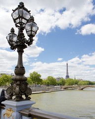 Seine View from Pont Alexandre III (Cameron (and Liz)) Tags: bridge blue trees light sky paris france green tower water lamp seine architecture clouds river scenic eiffel gustaveiffel worldsfair pontalexandreiii truss artneuveau