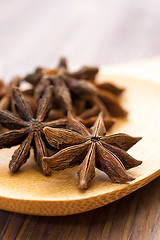 Star anise (sun_tea86) Tags: wood food brown closeup star wooden drink board spice group large objects spoon bunch shape mulledwine scented anise aromatherapy staranise