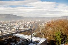 Accecarsi a gennaio (damar47) Tags: city winter sky mountains sunshine skyline clouds river landscape austria nuvole shine pentax hills graz shining pentaxk30