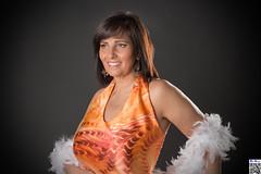 The orange dress (tnekralc) Tags: orange laura sexy smile eyes dress arms boobs cleavage moswl