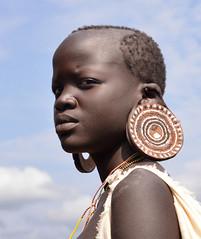 Suri Woman, Ethiopia (Rod Waddington) Tags: africa portrait people woman color colour female costume outdoor african traditional tribal afrika omovalley ethiopia tribe ethnic ethnicity afrique earplug ethiopian omo thiopien suri etiopia ethiopie etiopian kibish