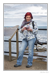 KC (Seven_Wishes) Tags: street camera uk red portrait people woman lady scarf person pretty photographer outdoor candid cellphone blouse redhead jeans coastal mature mobilephone kc gs newcastleupontyne whitleybay tyneandwear jdo northtyneside canonef24105mmf4lis edoliver femalephotographer photoborder karencrawford 7wishes canoneos5dmark3 newcastleupontynenortheast 7wishesphotography