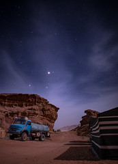 Water Truck Under Stars (Themightyoak) Tags: life travel sky cloud mountains night clouds canon stars mercedes rocks desert 14 wadirum tent jordan rum 24mm wadi musa supply 6d wadimusa samyang canon6d