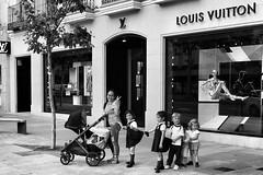 image (Luis Iturmendi) Tags: madrid street people blackandwhite bw blancoynegro monochrome childhood monocromo calle child gente nanny streetphotography nios niera