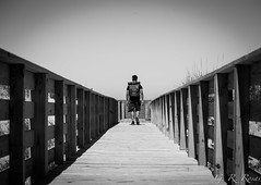 Take a walk alone. (gregori.rosas) Tags: north carolina boardwalk nc beach bw blackandwhite