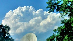 Cloud Formation. (dccradio) Tags: trees sky cloud blur tree nature weather clouds nc blurry northcarolina bluesky blurred greenery cloudformation fairmont satellitedish