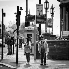 Help point (John Riper) Tags: street uk england people bw white signs man black monochrome liverpool canon john booth square point photography lights mono traffic zwartwit box candid telephone poor machine cash help l service kiosk blackie 6d 24105 straatfotografie riper johnriper