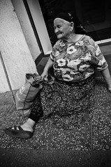 Sometimes the Poor Are Easy to Overlook (stimpsonjake) Tags: city blackandwhite bw woman monochrome sitting candid homeless poor streetphotography sidewalk romania bucharest 185mm nikoncoolpixa