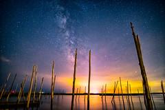 Milky Way vs Light Pollution (DJawZ) Tags: ocean city sunset sky water skyline night clouds dark skyscape stars landscape bay pier dock long exposure nightscape outdoor astro atlantic astrophotography serene hdr milkyway